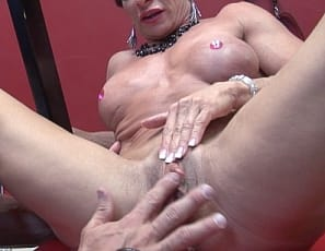 Female bodybuilder Anna Phoenixxx is chained up on a fucking machine in high heels, trying to use the mature muscles of her vascular biceps, powerful pecs, ripped abs, and strong glutes and legs to get away. But then she gets an endurance test, taking off her panties and High heels and getting her big clit sucked and pussy masturbated while you watch in close-up, and she doesn't mind.