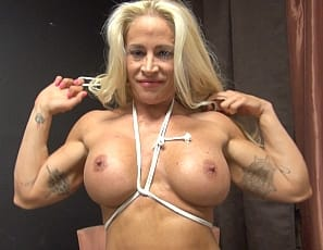 Professional bodybuilder Jill Jaxen seems to love being tied up. In fact, once she uses her powerful muscles (biceps, abs, legs) to break free from her restraints she ties herself back up just to tease you.