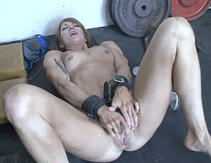 Beautiful and ripped. Tattooed, powerful and muscular. This ravishing redhead has it all. From the moment you see her powerful biceps, to the moment she uses her bound hands to play with her pussy, you will be mesmerized. Charlotte in the bound and in the gym, what a beautiful sight she is!