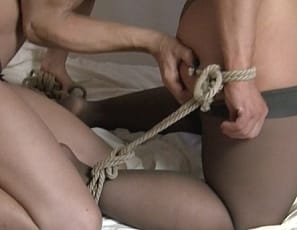Bodybuilder Genie's taken is in her bra, panties and stockings and is getting tied up in the bedroom. While she's bound, her friend worships her ass and muscles for some girl/girl fun.
