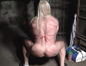 Lacey has been uncharacteristically lazy at the gym today - she was NOT going deep enough on her squats. Her trainer is very displeased with her and doesn't mind demonstrating his displeasure. He begins to cane her glutes, quads, and back every time she fails to perform her move the appropriate way. Lacey takes her caning like a sport - almost too well. Like she enjoys it! Watch and see for yourself.