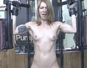 Charlotte again proves how innovative she is when it comes to masturbating in the gym. Sure, she's restrained and the big black dildo is already in place, but you can't tell me the sexy redhead didn't have a  hand in setting this up!
