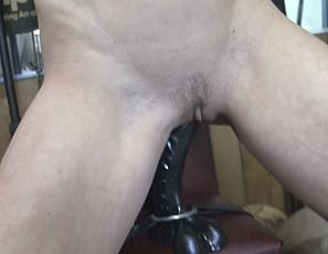 Sexy redhead Charlotte is bound in the gym and masturbating by riding a big black dildo. She gets nice and wet as she rides her toy and she gets a little POV help from her workout partner. How much more can she take before she cums all over that dildo? Well, you'll just have to watch and see!