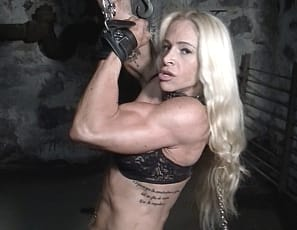 Professional female bodybuilder Jill Jaxen may have ripped abs, vascular biceps, and muscular pecs, legs, and glutes, but they're not getting her out of her chains in a dungeon. I'm supposed to be in charge here, she shouts.