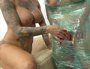Female bodybuilder and muscle porn star BrandiMae's been wrapped up tight in plastic by Mistress Dani Andrews, but her vascular, tattooed muscles are making her hot and sweaty. Soon, the plastic is ripped away from her ripped abs, vascular biceps and pecs; then, some girl/girl fun makes BrandiMae feel better. You get to watch in close-up.
