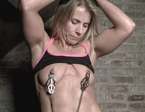 Claire once again finds herself in the dungeon, chained up. How does this keep happening to her? We are not really sure, but we certainly enjoy watching Claire struggle against her restraints and her keepers advances. Claire warns him, You're getting a little comfy there. when he reaches out an touches her pecs and nipples. We are also treated to Claire's ripped abs, biceps and pretty pussy.