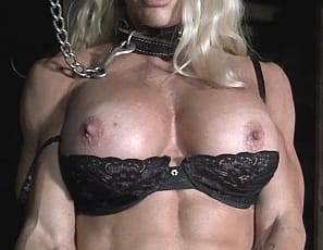 Ripped and vascular female bodybuilder Jill Jaxen is retrained and naked in the dungeon, and she is not happy about it. Even though she appears to enjoy showing off her fantastic physique (muscular biceps, ripped abs, powerful quads) she would prefer to do it on HER terms, not his. For his sake I hope she never escapes!