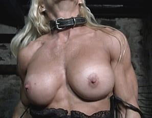Fucker! That's the name that bodybuilder Jill Jaxen calls her captor while warning him that he better hope she doesn't get lose! Look at Jill's huge, powerful muscles - imagine what she would do to him if she ever got her powerful quads wrapped around his neck.