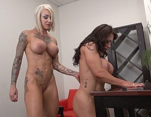 Dani Andrews is still tickling and teasing poor BrandiMae whose muscles are tired from pushing and pulling against her restraints. Tattooed and ripped, Dani decides to give muscular female BrandiMae's biceps and pecs a break by releasing her. Dani then orders her over to the table - what could she have in store?