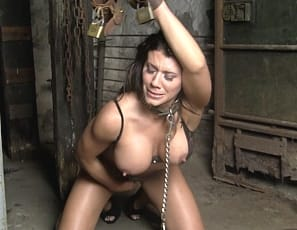 Female muscle porn star Leena is chained up in a dungeon in high heels, and using the muscles of her pecs, biceps, abs, legs and glutes to try to get free. Maybe taking off her panties to masturbate will help?