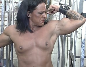 Muscle porn star Goddess of Iron is a ripped, vascular, tattooed female bodybuilder, but even her muscular pecs, biceps, abs and legs aren't helping her escape being chained up in the gym. Fortunately, there's a toy she can ride. Watch her big clit cum in close-up as she tries to get free.