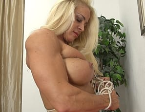 Professional female bodybuilder Jill Jaxen is naked and bound, and struggling with the ropes so she can use her powerful pecs, ripped abs, vascular biceps, muscular, tattooed legs and glutes to escape. Watch to the end to see what happens.