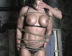 Female bodybuilder and muscle porn star Bella is in stockings and all tied up.  She wants to be let go, but instead her vascular biceps ripped ab muscles, pecs and legs are getting worshiped. To get free, she has to give a blowjob. You get to watch in close-up.