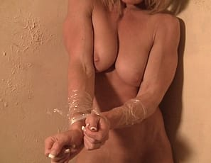 Female bodybuilder Tanya is wrapped in plastic, but she's finally able to tear it off and pose naked in high heels to show you the muscles of her pecs, vascular biceps, glutes, legs and ripped abs, and give you a look at her pretty kitty.