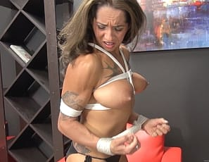 Tattooed female bodybuilder Bobbi is all bound up, but she can't help posing, then reaching into her panties and masturbating while you watch in close-up and enjoy looking at the vascular, ripped muscles of her pecs, biceps, legs, glutes, and abs as she struggles. If you like female muscle bondage porn, you'll want to watch this over and over.