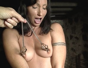 Wenona's in the dungeon, all bound up in leather and clamped up too. She can't use he tattooed biceps, her pecs, her abs or her muscular legs and glutes to get away or keep her ass and pussy safe.  Bur she can moan and scream. And you can watch.