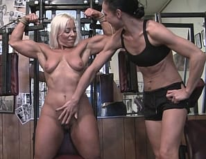 Bodybuilder Genie's taken off her panties and is Posing naked in the gym, accepting a challenge that she can't get out of the ropes her friend has tied her up in. While she's bound, her friend worships her muscular Pecs, Biceps and Abs for some girl/girl fun.