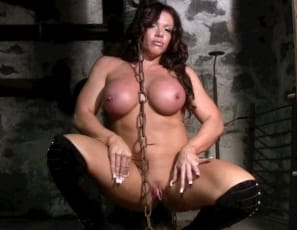 You may not know that SheMuscle has a dungeon – we save it just for members who've been bad. But when bodybuilder MuscleBunny, completely naked except for her thigh-high high-heeled lace-up boots, wanted to visit, we decided to follow her as she checked out the chains. Watch the video as she poses, showing just how she'd chain up someone who needs to be punished.